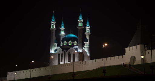 People walk at night near the mosque Footage