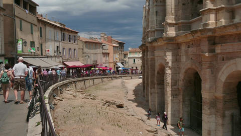 Tourists Visiting The French City Of Arles With Amphitheatre Arena Footage