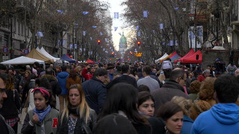 People celebrating Argentina 200 years independence day commemoration with the C Live Action