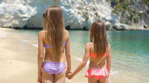 Active little girls at beach having a lot of fun Footage