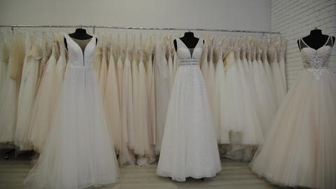 Beautiful wedding dresses in a bridal salon Live Action