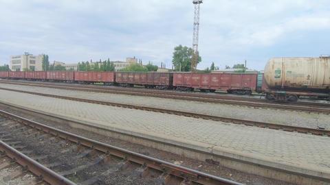 Freight wagons Ukrainian Railways on the platform of the railway station Live Action