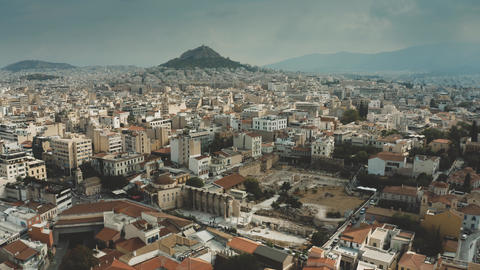 Aerial view of the cityscape of Athens, Greece. Flight from the Acropolis Footage