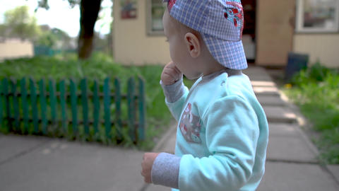 Cheerful view of a small blond toddler that, putting his fingers in his mouth Footage