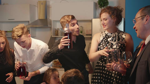 Group of people celebrate at the kitchen Footage