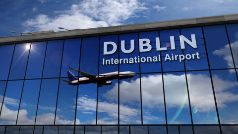 Airplane landing at Dublin mirrored in terminal Live Action
