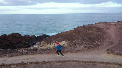 Aerial view of woman runnning along the nature reserve. Healthy active lifestyle Footage