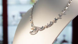Jewellery.Silver necklace with pearls in the jewelry store Live Action