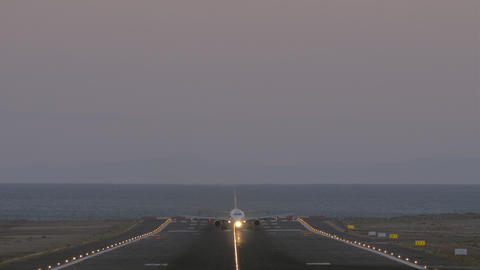 Aircraft evening departure from coastal airport, front view Live Action