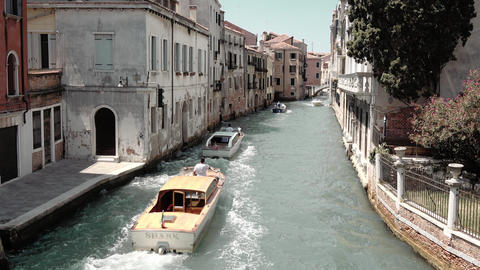 Panoramic view of Venice narrow canal with historical buildings and boats Footage