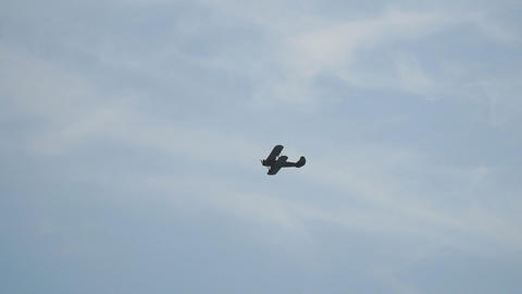 Ancient Russian aircraft biplane An2 flying in the blue sky Footage