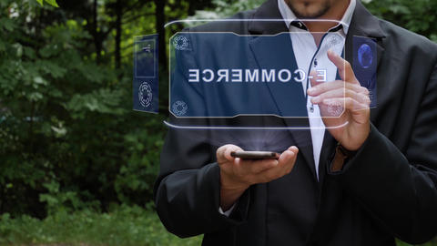 Businessman uses hologram with text E-commerce Live Action