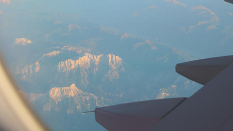 Snowy Peaks From Airplane Live Action