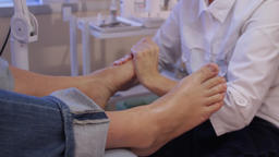 Podology.The podologist massages the patient's feet Live Action