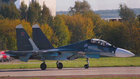 A reactive dark fighter airplane is gaining speed on the runway Footage