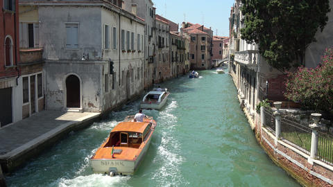 Panoramic view of Venice narrow canal with historical buildings and boats Live Action