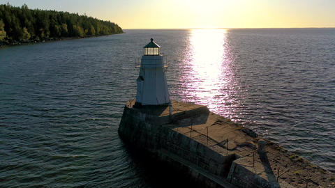 Beautiful Classic Light House at Sunset Aerial Live Action