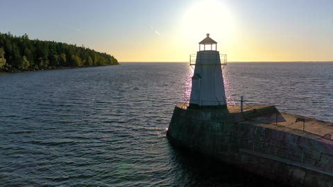 Dynamic Aerial of Classic Light House at Sunset Live Action