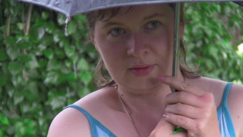 woman under an umbrella Stock Video Footage