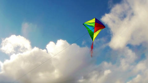 Kite Flying in the blue sky with clouds Stock Video Footage