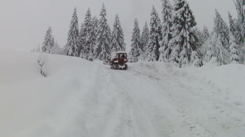 Bulldozer moving on snowy road, slow motion Stock Video Footage