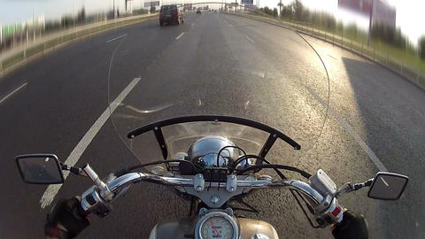 Biker driving the motorcycle on city highway, POV Footage