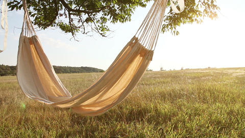 Hammock swinging on the wind at sunset Stock Video Footage