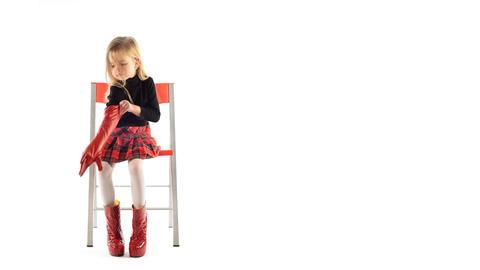 little girl wears a glove Stock Video Footage