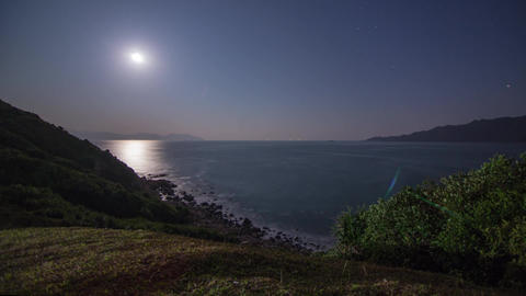 Moon rising with sea traffic Stock Video Footage