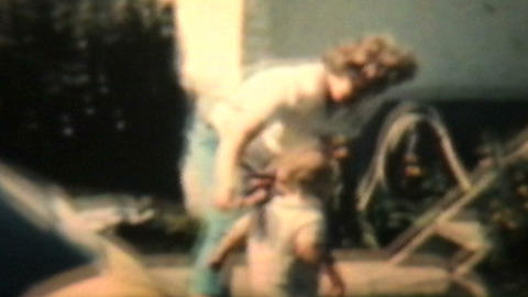 Boy Plays With Garden Hose 1963 Vintage 8mm film Stock Video Footage