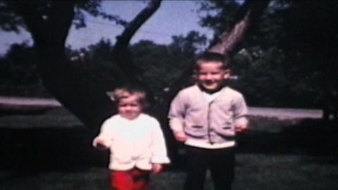 Brother And Sister Play Outside 1968 Vintage 8mm film Footage