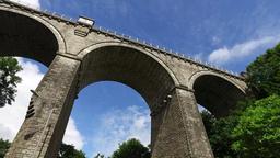 Facing upward perspective of driving under tall Cornwall Railway bridge in Newqu Footage