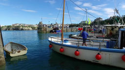 Harbor Fisherman anchoring fishing boat in harbour, Newquay, Cornwall Footage