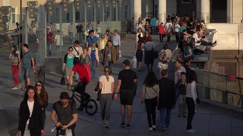 Unidentified рeople stroll on Patriarshy bridge, slow motion Footage