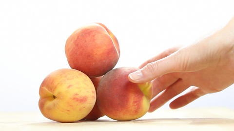 Peaches on a white background Footage