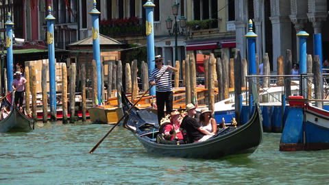 Gondola ride in Venice - the ultimate tourist attraction Live Action