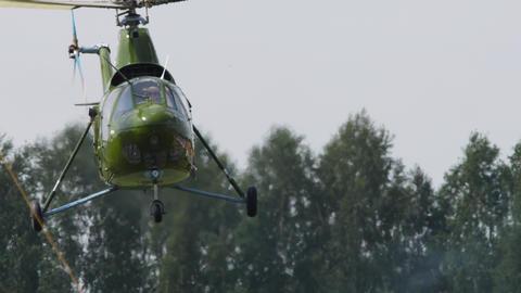 Vintage Helicopter Mi-1 performance aerobatics Live Action