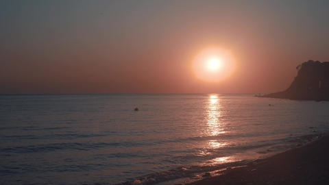Sea shore on a beautiful sunset background. Sea beach against the backdrop of Footage