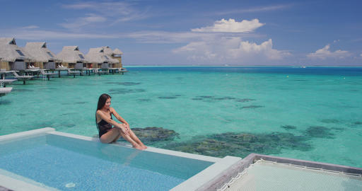Pool Beach Luxury Winter Vacation Woman in bikini in luxury overwater bungalow Live Action