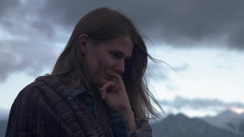 Portrait of a young romantic girl on a background of mountains. A beautiful girl Footage