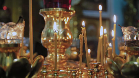 Candles on a candlestick in a church. Religious holiday Live Action