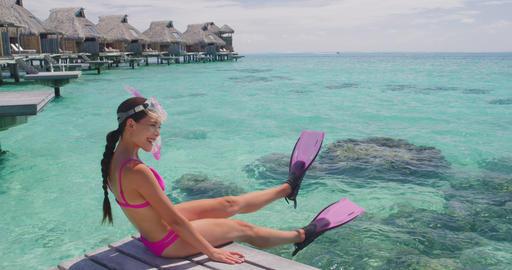 Beach Luxury Travel Vacation in Tahiti. Snorkel swim woman going snorkeling Live Action