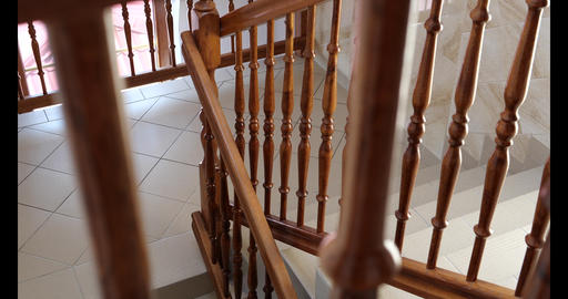 4k - Staircase in the house, going down with a wooden railing in slow motion Live Action