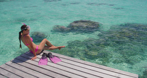 Beach Travel Vacation in Tahiti. Snorkel swim woman going snorkeling Live Action