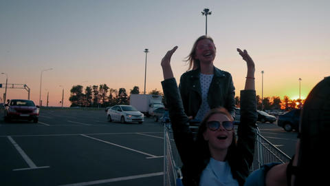 Slow motion two young millennials girl are having fun together racing on Footage