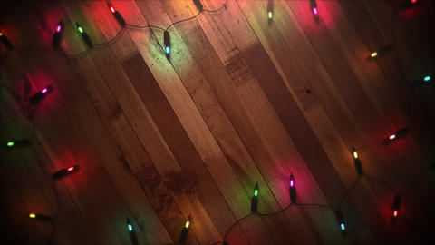 Animated closeup colorful garland on wood background Animation