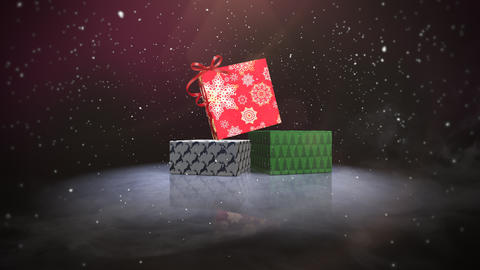 Animated closeup Christmas gift boxes on snow and shine background Animation