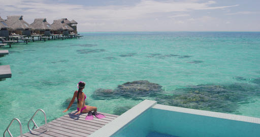 Travel Vacation in Tahiti. Snorkel swim woman going snorkeling Live Action