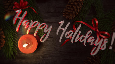 Animated closeup Happy Holidays text, candle and green tree branches on wood Animation