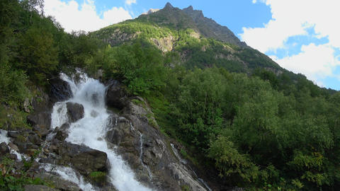 Waterfall scenes in mountains, national park of Dombay, Caucasus, Russia Footage